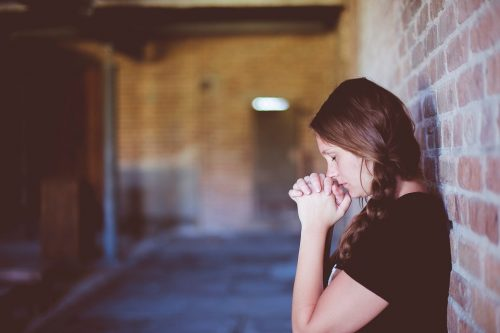 Online Therapy can save you from anxiety. The girl looking is praying and looking for someone to help her.